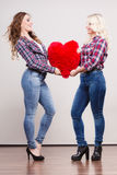 Adult daughter and mother with heart love sign Stock Image