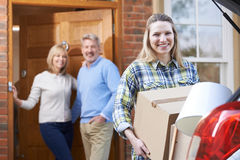 Adult Daughter Moving Out Of Parent's Home Royalty Free Stock Photos