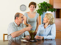 Adult daughter and parents with money Royalty Free Stock Photos