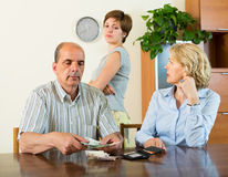 Adult daughter and parents with money Royalty Free Stock Images