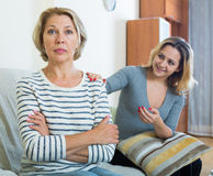 Adult daughter wants to reconcile with offended mature mother Stock Image