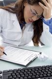 Adult doctor in tension Stock Photo