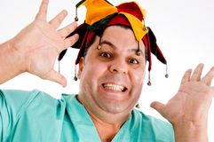 Adult doctor wearing colorful hat giving Stock Image