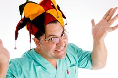 Adult doctor wearing colorful hat giving Stock Images