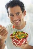 adult eating man mid salad Στοκ φωτογραφίες με δικαίωμα ελεύθερης χρήσης