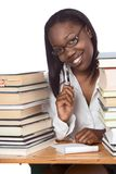 Adult education Afro American woman book studying. African-American ethnic black young female student in eyeglasses with pen and notepad sitting at school desk Royalty Free Stock Photography