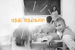Adult education against students in a classroom stock photography