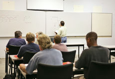 Adult Education Class. An adult education teacher in front of his class, drawing a diagram on the board. Focus on teacher and diagrams. FILE ID: 2721612 royalty free stock photos