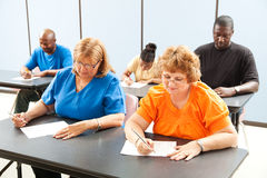 Adult Education Class - Exams. Diverse adult education or college class taking a test stock photos