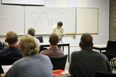 Adult Education - Electrical. An adult education class in electricity. Focus on the electrical circuit diagram on the board. FILE ID: 2721619 royalty free stock image