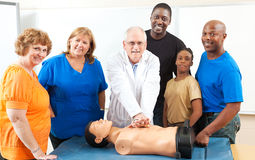 Adult Education First Aid Class. Adult education class learning CPR first aid from a doctor royalty free stock image