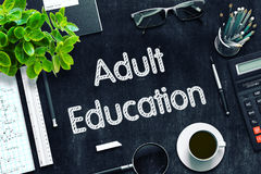 Adult Education - Text on Black Chalkboard. 3D Rendering. Adult Education Concept on Black Chalkboard. 3d Rendering. Toned Image Stock Image