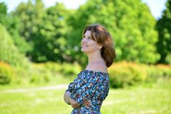 Adult elegant woman on the nature Stock Photography