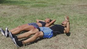 Couple exercising with legs up stock video