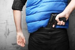 Adult European man with black pistol. Carrying weapons with you. Sense of security royalty free stock images