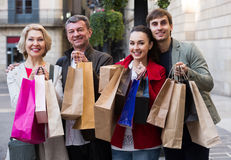 Adult family of four with shopping bags Royalty Free Stock Images