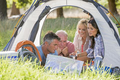 Adult Family Group Enjoying Camping Holiday In Countryside royalty free stock image