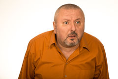 Adult fat man looking at camera stunned Royalty Free Stock Image