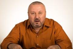 Adult fat man looking at camera stunned Stock Photo