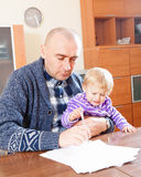 Adult father and baby daughter working Stock Image