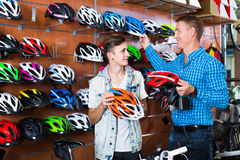 Adult father and son choosing bicycling helmet Stock Image