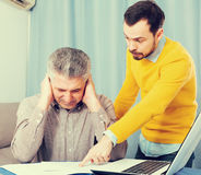 Adult father and son discuss contract Royalty Free Stock Photos