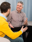 Adult father and son friendly conversation Royalty Free Stock Photo