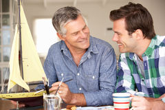 Adult father and son model making. At home Stock Photography