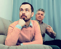 Adult father and son solve problems Stock Images