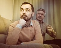 Adult father and son solve problems Royalty Free Stock Photos