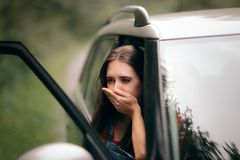 Car Sick Travel Woman with Motion Sickness Symptoms. Adult feeling nauseated after traveling with an automobile stock images