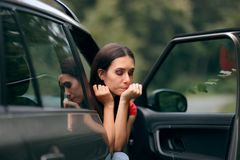 Car Sick Travel Woman with Motion Sickness Symptoms. Adult feeling nauseated after traveling with an automobile stock image