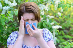 Adult female with allergic rhinitis about bird cherry blossoms Royalty Free Stock Photos