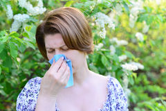 Adult female with allergic rhinitis about bird cherry blossoms Royalty Free Stock Image