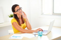Adult female employee surfing the web for work Stock Image