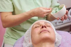 Adult female face, dermatology clinic. Person at the cosmetician stock photo