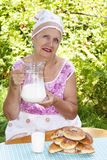 The adult female with fresh milk Stock Image