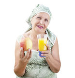 Adult female with fresh ripe apple and orange juice Royalty Free Stock Photos