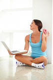 Adult female holding food and laptop Royalty Free Stock Photos
