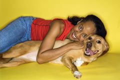 Adult female hugging dog. Royalty Free Stock Photos