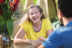 Adult Female Laughing with Friend Royalty Free Stock Image