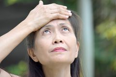 Adult Female Memory Problems. An attractive and asian person stock image