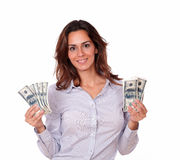 Adult female standing and holding dollars Royalty Free Stock Photos
