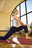 Adult Female Stretching At Gym Royalty Free Stock Photos