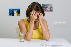 An adult female suffers from a severe headache. royalty free stock images