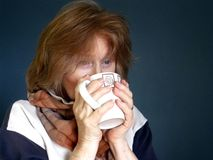 Adult Female with warming mug of hot drink Stock Photos