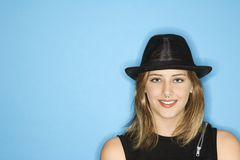 Adult female wearing hat smiling. Stock Image