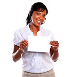 Adult female wearing headphones holding white card Stock Photo