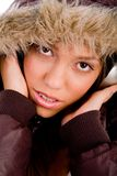 Adult female with woolen coat listening music Stock Photos