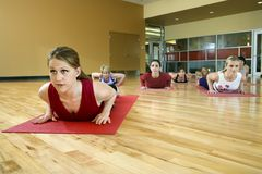 Adult females in yoga class. Royalty Free Stock Photo